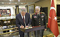 U.S. Secretary of Defense Chuck Hagel, left, signs a guest book at the Turkish General Staff headquarters in Ankara, Turkey, as Turkish army Gen. Necdet Özel, the chief of the Turkish General Staff, stands by 140908-D-NI589-532.jpg