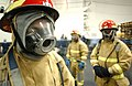 US Navy 030104-N-9964S-006 Sailors prepare to conduct a training exercise, designed to simulate fighting an aircraft fire.jpg