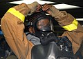 US Navy 031015-N-8955H-008 Mess Management Specialist 3rd Class Latoya Black from Detroit, Mich., tightens the upper strap of her Oxygen Breathing Apparatus.jpg