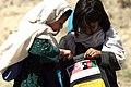 US Navy 040513-M-8683D-004 Afghan children look through school supplies provided by U.S. Marines.jpg