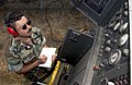 US Navy 040817-N-4385W-008 Construction Electrician 2nd Class Carlos Villalobos of South Gate, Calif., performs maintenance on a 30-killowatt generator in preparation for Operation Seahawk 2004.jpg