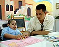US Navy 041127-N-8801B-080 Culinary Specialist 2nd Class Gerardo Reyes, assigned to the amphibious assault ship USS Essex (LHD 2), spends time on a community relations visit to the Dubai Center for Special Needs.jpg