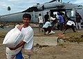 US Navy 050113-N-8629M-160 U.S. Navy air crewman deliver supplies to tsunami victims at a small village on the island of Sumatra.jpg