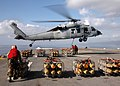 US Navy 050207-N-2059B-007 An MH-60S Seahawk helicopter prepares for departure from the flight deck of the amphibious assault ship USS Belleau Wood (LHA 3), with a pallet of bombs during an ammunition offload.jpg