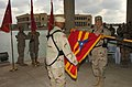 US Navy 050209-N-5319A-001 U.S. Army Brig. Gen. Richard P. Formica rolls up the command flag of III (US) Corps Artillery during a transfer of authority ceremony at Camp Victory in Baghdad, Iraq.jpg