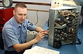 US Navy 050317-N-6997B-002 Mineman 1st Class Jack Angle, assigned to Mobile Mine Assembly Detachment (MOMAD) Twelve, Misawa, Japan, conducts preventive maintenance on a test set for the MK-56 anti-submarine warfare mine.jpg