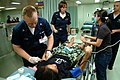 US Navy 050406-N-0357S-008 Hospital Corpsman 2nd Class Jason Moore prepares to put an IV in the arm of an Indonesian women suffering from an ankle injury.jpg