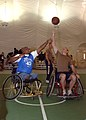 US Navy 070416-N-1132M-006 Dwayne Gratsy, from the local branch of the Paralyzed Veterans of America (PVA), tips off for his team against Lt. j.g. Jerod McCully for the Seabees in a basketball game.jpg