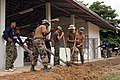 US Navy 070507-M-7416H-014 Seabees of Naval Mobile Construction Battalion (NMCB) 3 paint and add finishing touches to a schoolhouse in Ban Nong Krob, in support of Cobra Gold 2007.jpg