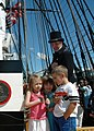 US Navy 070622-N-2893B-001 With a little help from Command Senior Chief Don Abele, three children lead hundreds of invited guests in reciting the pledge of allegiance while aboard USS Constitution.jpg