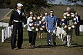 US Navy 071021-N-5319A-013 During a visit to Arlington National Cemetery, family members of Navy SEAL Lt. Michael Murphy carry wreaths to lie at the gravestones of service members killed by the same enemy forces as their son.jpg