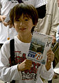 US Navy 080608-N-1251W-004 A Japanese child holds up his copy of the manga.jpg