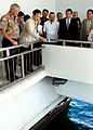 US Navy 081006-N-5174T-086 Tamio Mori, mayor of Nagaoka City, Japan, drops a flower into the water beneath the USS Arizona Memorial to honor service members killed in World War II.jpg