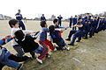 US Navy 090207-N-8546L-744 Sailors assigned to the amphibious command ship USS Blue Ridge (LCC 19) and embarked U.S. 7th Fleet staff Sailors play tug-of-war with orphans from the Myojoo-en Children's Home during a community out.jpg