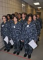US Navy 090430-N-8848T-972 Female recruits wait to have their newly issued navy working uniform examined by seamstresses at Recruit Training Command.jpg