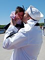 US Navy 090521-N-8750E-139 Hospital Corpsman 1st Class Chris Yaras kisses his daughter for the first time during the return of the Los Angeles class fast-attack submarine USS Hartford (SSN 768) to Naval Submarine Base New Londo.jpg