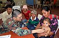 US Navy 090626-F-7885G-043 Air Force Maj. David Hsieh, embarked aboard the Military Sealift Command hospital ship USNS Comfort (T-AH 20), examines a young boy during a Continuing Promise 2009 medical community service project.jpg