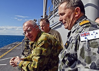 Disruptive Pattern Camouflage Uniform - Disruptive Pattern Naval Uniform (grey) on the right, worn by VADM Russ Crane.