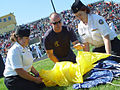 US Navy 090902-N-2888Q-072 ames Woods, center, a retired Navy SEAL and safety officer with the U.S. Navy parachute team, the Leap Frogs, shows Navy Junior ROTC cadets from Franklin Heights High School how to pack a parachute.jpg