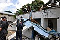 US Navy 091003-F-3798Y-335 ailors assigned to the guided-missile frigate USS Ingraham (FFG 61) clear away a damaged roof during disaster recovery efforts in Pago Pago, American Samoa.jpg