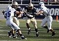 US Navy 091003-N-3404S-163 U.S. Naval Academy safety Emmett Merchant (^7) gets a block from linebacker Tyler Simmons (^54).jpg