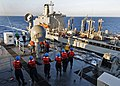 US Navy 100201-N-1082Z-018 Sailors, assigned to the amphibious dock landing ship USS Ashland (LSD 48) handle lines during a replenishment at sea with the Military Sealift Command fleet replenishment oiler USNS Big Horn (T-AO 19.jpg
