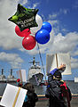 US Navy 100412-N-4774B-399 Balloons and signs held by family members and friends greet Sailors assigned to the guided-missile cruiser USS Bunker Hill (CG 52) as they arrive home after returning from a three-month deployment.jpg