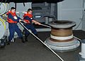 US Navy 100924-N-6632S-076 Deck department Sailors heave a line around a capstan aboard the aircraft carrier USS George H.W. Bush (CVN 77).jpg