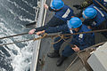 US Navy 110126-N-9589S-099 Sailors heave a line during an underway replenishment aboard USS Truxtun (DDG 103).jpg