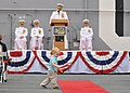 US Navy 110421-N-DX615-011 A boy plays in the aisle as Vice Adm. Gerald R. Beaman, incoming commander of U.S. 3rd Fleet, speaks during the U.S. 3rd.jpg