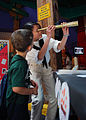 US Navy 110506-N-AU127-028 Airman Sang Nguyen, assigned to USS Constitution, shows an 1812-era telescope to a child at the Louisiana Children's Mus.jpg