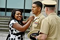 US Navy 110519-N-ZB612-116 Chief Construction Electrician Leonardo Calderon has his chief's anchors pinned by his wife, Jamiah, during his meritori.jpg