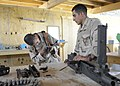 US Navy 110621-N-PC077-170 Seabees disassemble an M2H .50-caliber machine gun during a training exercise.jpg