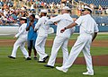 US Navy 110806-N-JP983-033 Sailors representing air, submarine and surface commands throw the first pitch during a Norfolk Tides baseball game at H.jpg