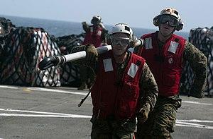 US Navy 111210-N-PB383-806 Marines assigned to the 11th Marine Expeditionary Unit (11th MEU) retrieve a cargo holder aboard the amphibious transpor.jpg