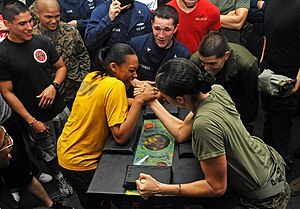 US Navy 111211-N-DX615-040 Seaman Denise Williams and Marine Sgt. Amanda Joseph, participate in an arm wrestling competition aboard the amphibious.jpg