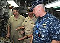 US Navy 120126-N-BK435-036 Adm. Cecil Haney speaks with Capt. Pete Hildreth and David Every of the Military Sealift Command, the ship's chief engin.jpg