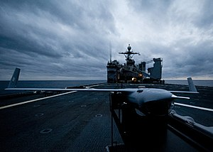 US Navy 120206-N-NR955-200 Scan Eagle, an unmanned aerial vehicle (UAV), sits on the flight deck after a successful test aboard the Whidbey Island.jpg