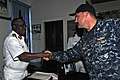 US Navy 120215-N-IZ292-001 Cmdr. Leonard Milliken, commanding officer of the guided-missile frigate USS Simpson (FFG 56), greets Nigerian navy Rear.jpg