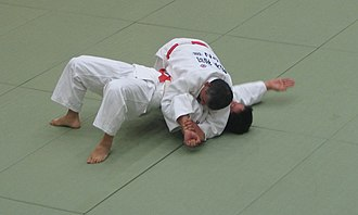 "Brazilian jiu-jitsu - An ""americana"" or ""paintbrush"" submission from traditional side control"