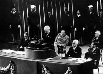 Alger Hiss - President Harry S. Truman addressing the United Nations Conference in San Francisco, California. From left to right: Unknown person, President Truman, Harry Vaughan, Secretary of State Edward Stettinius, and Alger Hiss. Armed Service personnel and the flags of nations are in the background, June 26, 1945