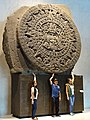 Visitors with Mexica Calendar Stone - Museum of Anthropology - Mexico City - Mexico (15486471736).jpg