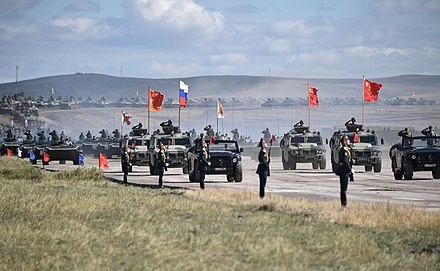 Chinese, Russian and Mongolian national flags set on armored vehicles during the large-scale military exercise Vostok 2018 in Eastern Siberia Vostok-2018 military manoeuvres (2018-09-13) 51.jpg
