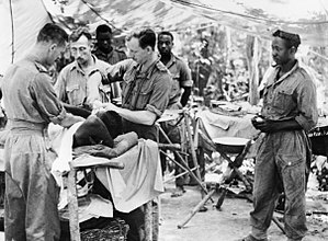 81st (West Africa) Division - Doctors operating on some of the 81st Division's casualties in Burma, August 1944