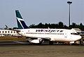Westjet Boeing 737-200; C-FIWJ, July 2003 (6169561288).jpg