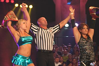 TNA Knockouts Tag Team Championship - Taylor Wilde (left) and Hamada (right) with the TNA Knockouts Tag Team Championship belts in July 2010