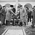 Winston Churchill greets Joseph Stalin with President Roosevelt outside the Livadia Palace during the Yalta Conference, February 1945. NAM232.jpg