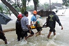 Woman in Sri Lanka rescued during monsoon flooding.jpg