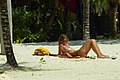 Woman sunning topless on beach in Jamaica.jpg