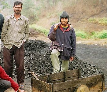 Workers outside a coalmine in the Jaintia Hills